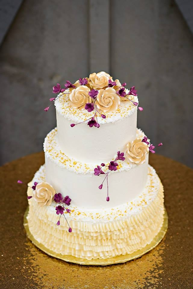 Purple and gold wedding cake